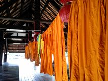 Row robes of Thai monks at HadYai ,Songkhla. Row robes of Thai monks in pavillion  at Thai  temple , HadYai ,Songkhla Royalty Free Stock Images