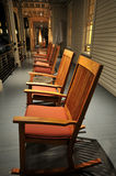 Row of rocking chairs on porch Royalty Free Stock Image