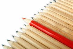 A row of rough graphite pencils with color red one Royalty Free Stock Image