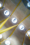 Row of round lamps on futuristic yellow ceiling Stock Photos