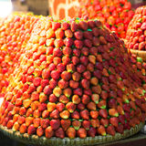 Row upon row of fresh, juicy  garden strawberries for retail sal. E at an outdoor market Royalty Free Stock Photography