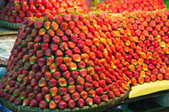 Row upon row of fresh, juicy  garden strawberries for retail sal. E at an outdoor market Stock Images