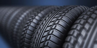 Row of rubber tire 3D, on blue. Background Stock Photography