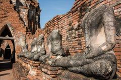 Row of ruin buddha statue in wat chai wattanaram, ayutthaya, thailand Stock Image