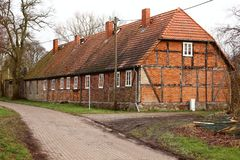 Row of rural workers houses, listed as monument in Schmoldow, Mecklenburg-Western Pomerania, Germany stock photos