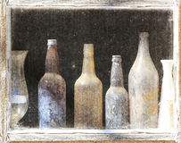 A row of rustic antique glass bottles. An abstract textured background of antique bottles Royalty Free Stock Images