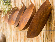 Row of rusty pans stock photos