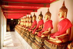Row of Sacred Buddha images in wat Phra Chetupon Vimolmangklararm (Wat Pho) temple Stock Photo