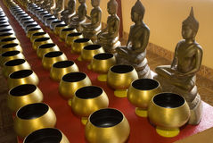 Row of sacrifice bowls  in temple 4. Row of sacrifice bowls at temple in Thailand Royalty Free Stock Photos