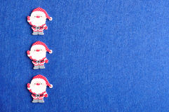Row of Santa clauses Stock Photos