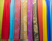 Row of scarves hanging in shop Stock Images