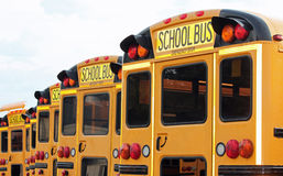 Row of School Buses. Lined up on the first day of school stock images