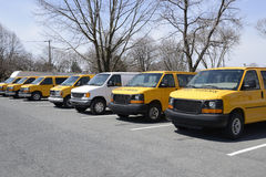 Row of school vans Stock Images