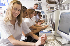 Row of schoolchildren studying on computers Royalty Free Stock Images