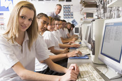 Row of schoolchildren studying on computers Royalty Free Stock Image