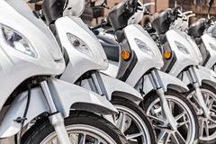 Row of scooter Stock Images