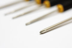 Row of screwdrivers. Close up of a crosshead screwdriver with others in the background Royalty Free Stock Photos