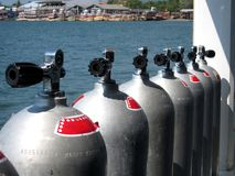 Row of scuba cylinders. Row of scuba tanks on a dive boat at sea in Thailand stock images