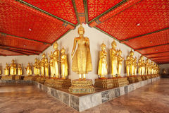 Row of seated Buddhas Stock Images