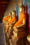 A row of seated Buddhas at the temple Stock Photo