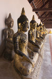 A row of seated Buddhas at a temple royalty free stock photography