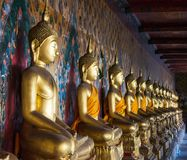 A row of seated Buddhas at the temple of Wat Arun in Bangkok, Thai royalty free stock photo
