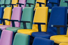 Row of Seats. Rows of empty brightly colored seats in a cinema, auditorium or lecture hall royalty free stock images