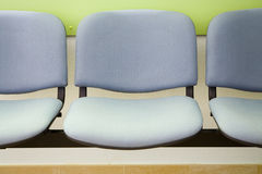 Row of seats. In public waiting area Stock Image