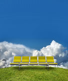 Row of seats in countryside Stock Images