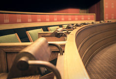 Row of seats and lamps in old sessions-hall. Royalty Free Stock Photo