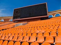 Row of seats and score board Royalty Free Stock Photos