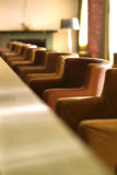 Row of seats in small bar. Cozy small bar in modern European style hotel Royalty Free Stock Photo