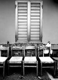 Row of seats under a window. In Southern Italy, typical scenery in small towns Stock Photo