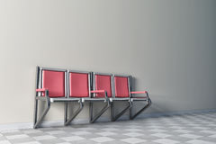 Row of seats on white wall Stock Image
