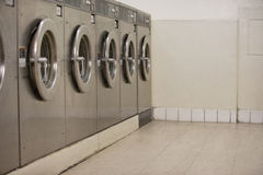 Row of self-service clothes dryers in Laundromat Royalty Free Stock Image