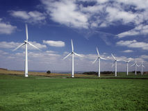 Row of seven wind turbines Royalty Free Stock Photos