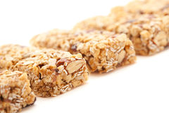 Row of Several Granola Bars Isolated on White Royalty Free Stock Images