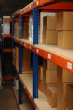Row of shelves with boxes on. Row of shelves with lots of cardboard boxes on Royalty Free Stock Photo