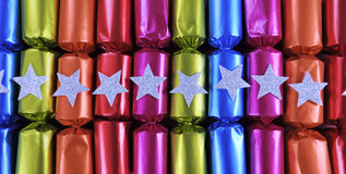 Row of shiny festive Christmas cracker bon bons Stock Images