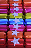 Row of shiny festive Christmas cracker bon bons Royalty Free Stock Photography