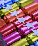 Row of shiny festive Christmas cracker bon bons Stock Photo