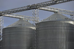A row of shiny, steel silo Stock Images
