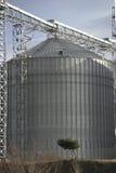 A row of shiny, steel silo Stock Image