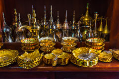 Row of shiny traditional coffee pots and lamp. At the souq in Dubai Stock Image
