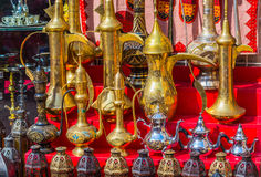 Row of shiny traditional coffee pots and lamp Stock Photo