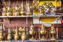 Row of shiny traditional coffee pots and lamp Royalty Free Stock Images