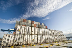 Row of shipping cargo containers Stock Photos