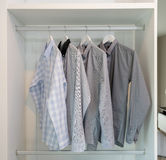Row of shirts hanging on coat hanger Royalty Free Stock Image