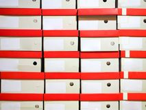 Row of shoes box stacked in storage royalty free stock photos