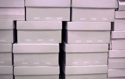 Row of shoes box stacked in store stock image